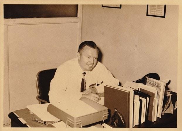 John Merrill sitting at desk